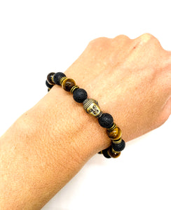 Buddha is a symbol of peace, love & enlightenment. Bracelet materials include 8mm lava & tiger's eye stones on an elastic cord with a bronze Buddha. Bracelet measures 7.25 inches for women and 7.75 inches for men. Custom sizing is available by Contacting Us.