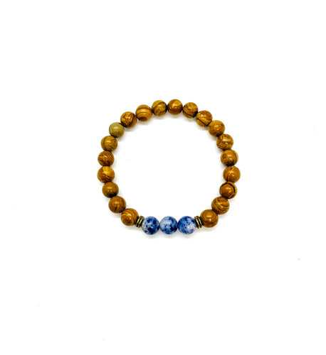 Sodalite is a stone that promotes communication & expression and is most associated with the throat chakra.  Bracelet materials include 8mm sodalite & wood grain stones on an elastic cord. Custom sizing is available by Contacting Us.