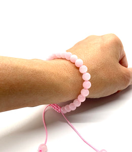 Rose Quartz is a pink stone that enhances love in all its many forms, romantic, family, Self & Universal, and it is most associated with the heart & crown chakras. Bracelet materials include 6mm rose quartz stones on an adjustable string that measures 6-9 inches to fit men, women & children. One size fits most.