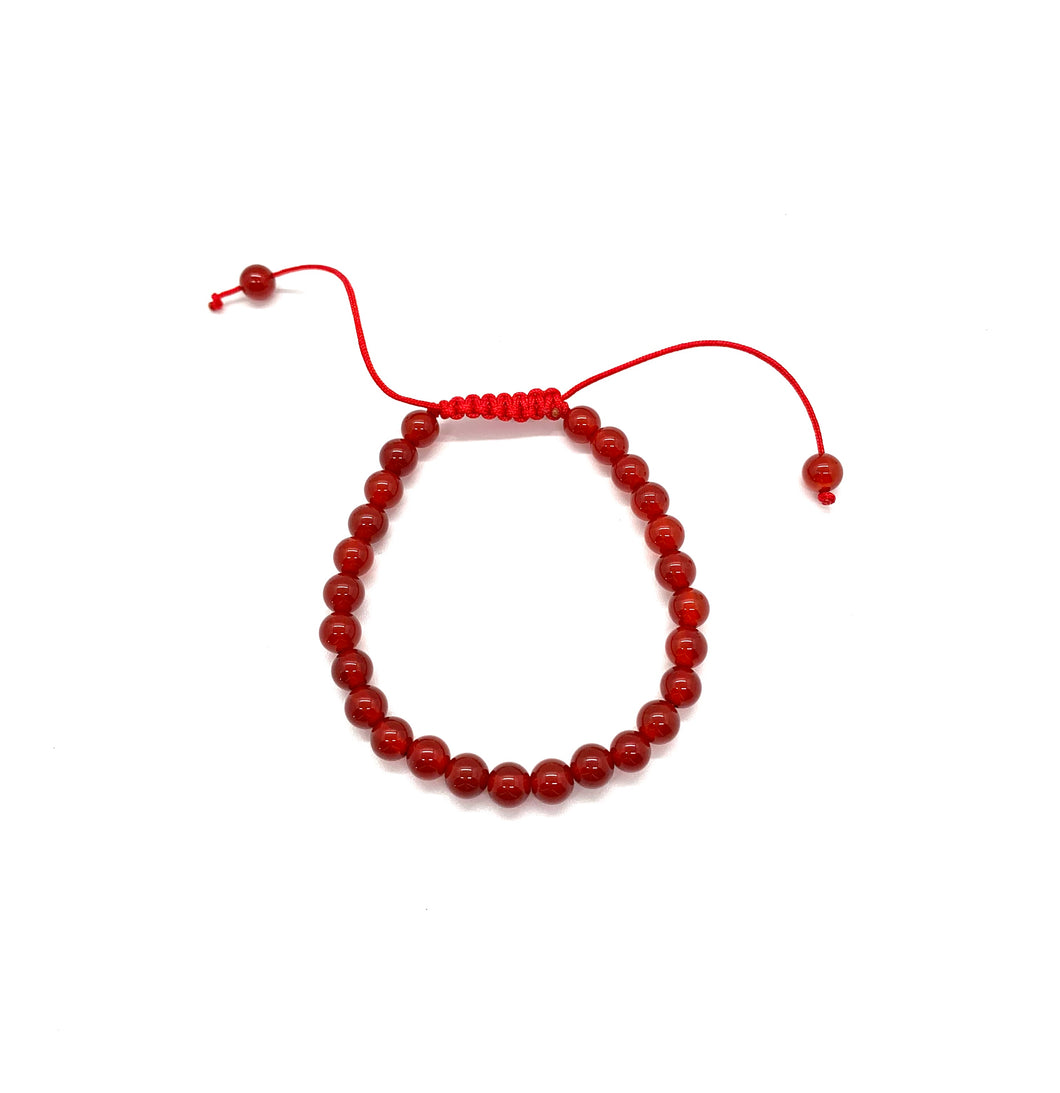 Agate is a muted red stone that promotes strength and is most associated with the root chakra. Bracelet materials include 6mm agate stones on an adjustable string that measures 6-9 inches to fit men, women & children. One size fits most.