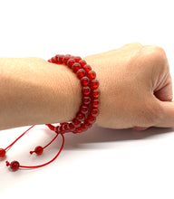 Load image into Gallery viewer, Agate is a muted red stone that promotes strength and is most associated with the root chakra. Bracelet materials include 6mm agate stones on adjustable string that measures 6-9 inches to fit men, women & children. Two bracelets come in this set.  One size fits most.