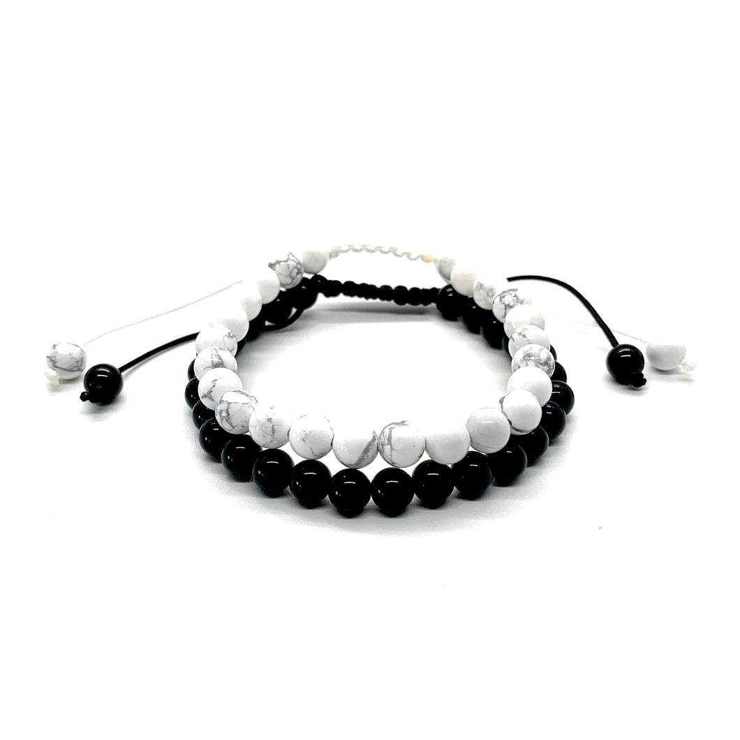 Wear these bracelets together so you can root to rise and create harmony and balance in your life! Howlite is a white marbleized stone that helps one tap into a higher consciousness and onyx is a shiny black stone that helps with power & grounding. Bracelet materials include 6mm howlite & onyx stones on adjustable string that measures 6-9 inches to fit men, women & children. Two bracelets come in this set.  One size fits most.