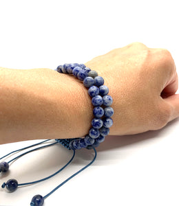 Sodalite helps stimulate truth, thought & communication and is most associated with the throat chakra. Bracelet materials include 6mm sodalite stones on adjustable string that measures 6-9 inches to fit men, women & children. Two bracelets come in this set. One size fits most.