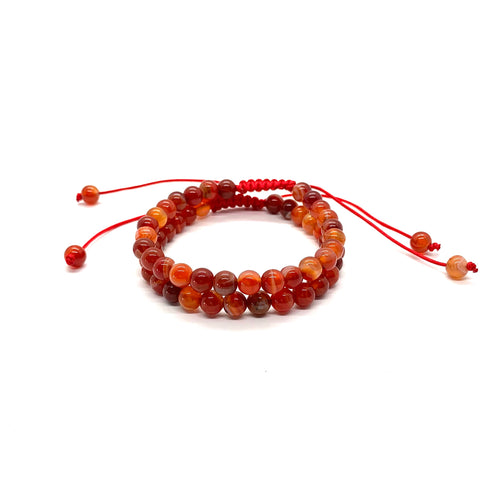 Carnelian is a reddish-orange stone that promotes courage, confidence & creativity and is most associated with the sacral chakra. Bracelet materials include 6mm carnelian stones on adjustable string that measures 6-9 inches to fit men, women & children. Two bracelets come in this set. One size fits most.