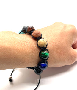 Ignite your inner strength & your nurturing essence with this agate & jasper macrame bracelet. Bracelet materials include 12mm assorted & agate and jasper stones on an adjustable string that measures 6-9 inches to fit men, women & children. One size fits most.