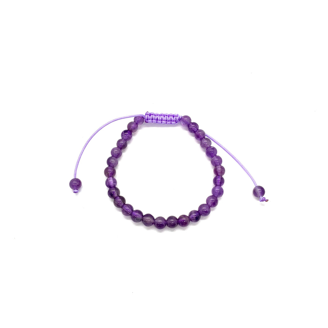Amethyst is a purple stone that promotes peace, healing & transformation and is most associated with the third eye chakra. Bracelet materials include 6mm amethyst stones on an adjustable string that measures 6-9 inches to fit men, women & children. One size fits most.