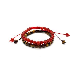 Wear these bracelets together for extra strength & protection! Agate is a muted reddish stone for strength and tiger's eye is a marbleized brown stone that protects the wearer. Bracelet materials include 6mm agate & tiger's eye stones on adjustable string that measures 6-9 inches to fit men, women & children. Two bracelets come in this set.  One size fits most.