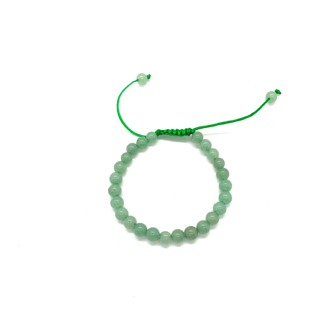 Aventurine is a green stone that brings forth prosperity, luck & abundance and is most associated with the heart chakra for love. It is also a stone that helps with fertility. Bracelet materials include 6mm aventurine stones on an adjustable string that measures 6-9 inches to fit men, women & children. One size fits most.