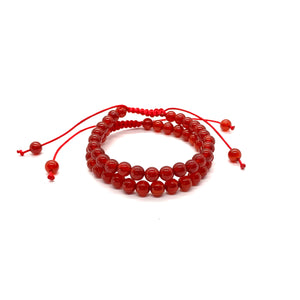 Agate is a muted red stone that promotes strength and is most associated with the root chakra. Bracelet materials include 6mm agate stones on adjustable string that measures 6-9 inches to fit men, women & children. Two bracelets come in this set.  One size fits most.