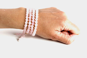 Rose Quartz is a soft pink stone that enhances love in all its many forms, romantic, family, Self, & Universal, and it is most associated with the heart & crown chakras.   Materials include 108, 6mm rose quartz stones that are strung on an elastic (stretch) cord for comfort & durability.  This mala is unisex and will likely wrap four times around the wrist for women & three for men. If worn as a necklace, it measures 28 inches.
