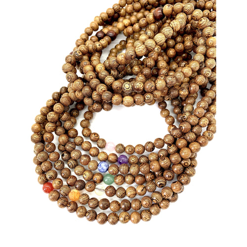 Materials include 108, 8mm light-weight sustainable wood beads that are strung on an elastic (stretch) cord for comfort & durability