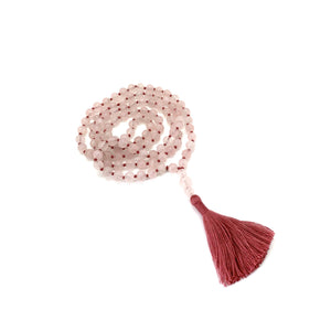 Materials include 108, 7mm rose quartz stones that are hand knotted on a pink cotton string w/ a two-inch pink cotton tassel