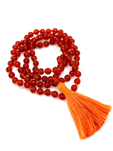 108 Red Agate Stones on a orange string with an orange tassel.