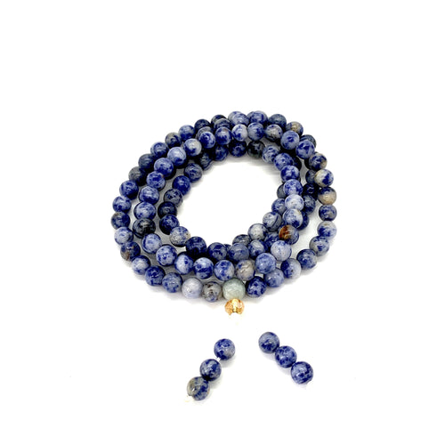 Sodalite is a blue & white marbleized stone that helps stimulate thought & promote communication and is most associated with the throat chakra.   Materials include 108, 6mm sodalite stones that are strung on an elastic (stretch) cord for comfort & durability.  This mala is unisex and will likely wrap four times around the wrist for women & three for men. If worn as a necklace, it measures 28 inches.