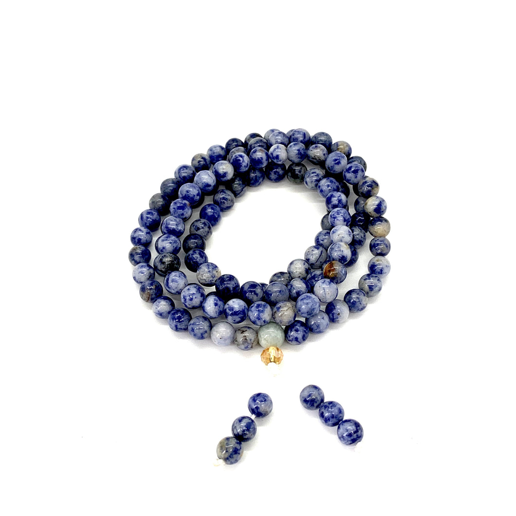 Materials include 108, 6mm sodalite stones that are strung on an elastic (stretch) cord for comfort & durability