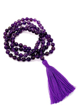 Load image into Gallery viewer, 108 Amethyst Stones on a purple string with a purple tassel.