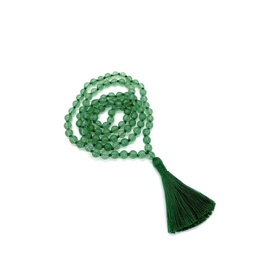 Materials include 108, 6mm green aventurine stones that are hand knotted on a green cotton string w/ a two-inch green cotton tassel