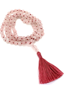 108 Rose Quartz Stones on a pink string with a pink tassel.