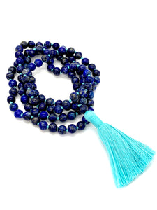 108 Lapsi Lazuli Stones on a turquoise string with a turquoise tassel.