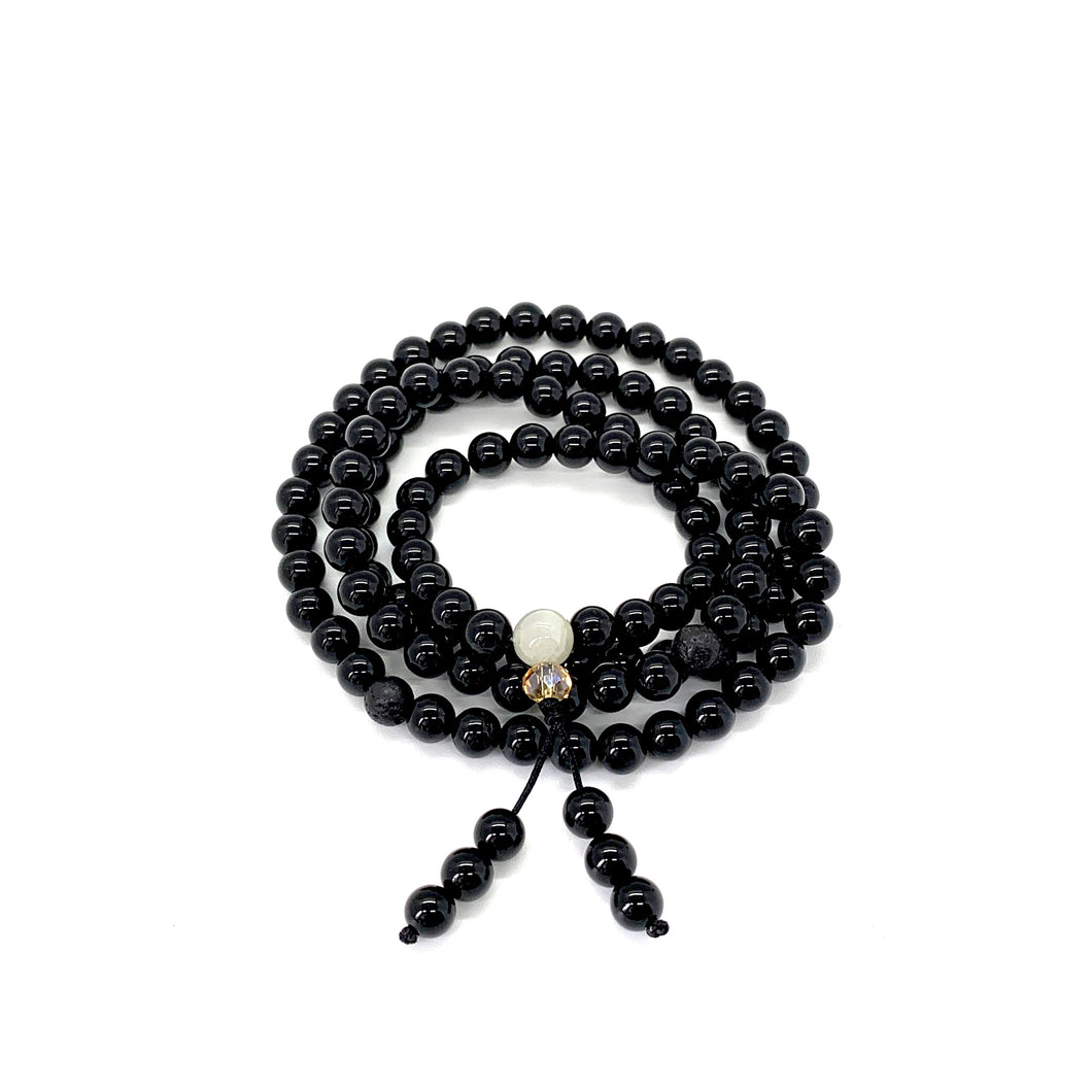 Onyx is a shiny black stone that inspires one to step into their personal power & is most connected with the root chakra.   Materials include 108, 6mm onyx stones & lava spacer beads that are strung on an elastic (stretch) cord for comfort & durability.  This mala is unisex and will likely wrap four times around the wrist for women & three for men. If worn as a necklace, it measures 28 inches.