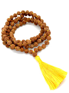 108 Rudraksha seed beads on a yellow string with a yellow tassel.