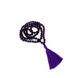 Amethyst is a stone for peace, healing & transformation and is most associated with the third eye chakra.  Materials include 108, 6mm amethyst stones that are hand knotted on a purple cotton string with a two-inch purple cotton tassel.  This mala is unisex and will likely wrap four times around the wrist for women & three for men. If worn as a necklace, it measures 34 inches.   A mala is a set of beads that are used as a meditation tool or as a simple reminder to stay present throughout the day.