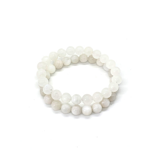 Bracelet materials include 8mm moonstones on an elastic cord