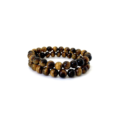 Bracelet materials include 8mm tigers eye stones on an elastic cord