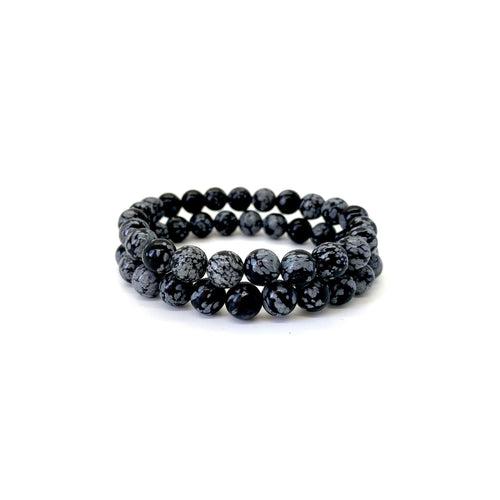 Bracelet materials include 8mm snowflake obsidian stones on an elastic cord