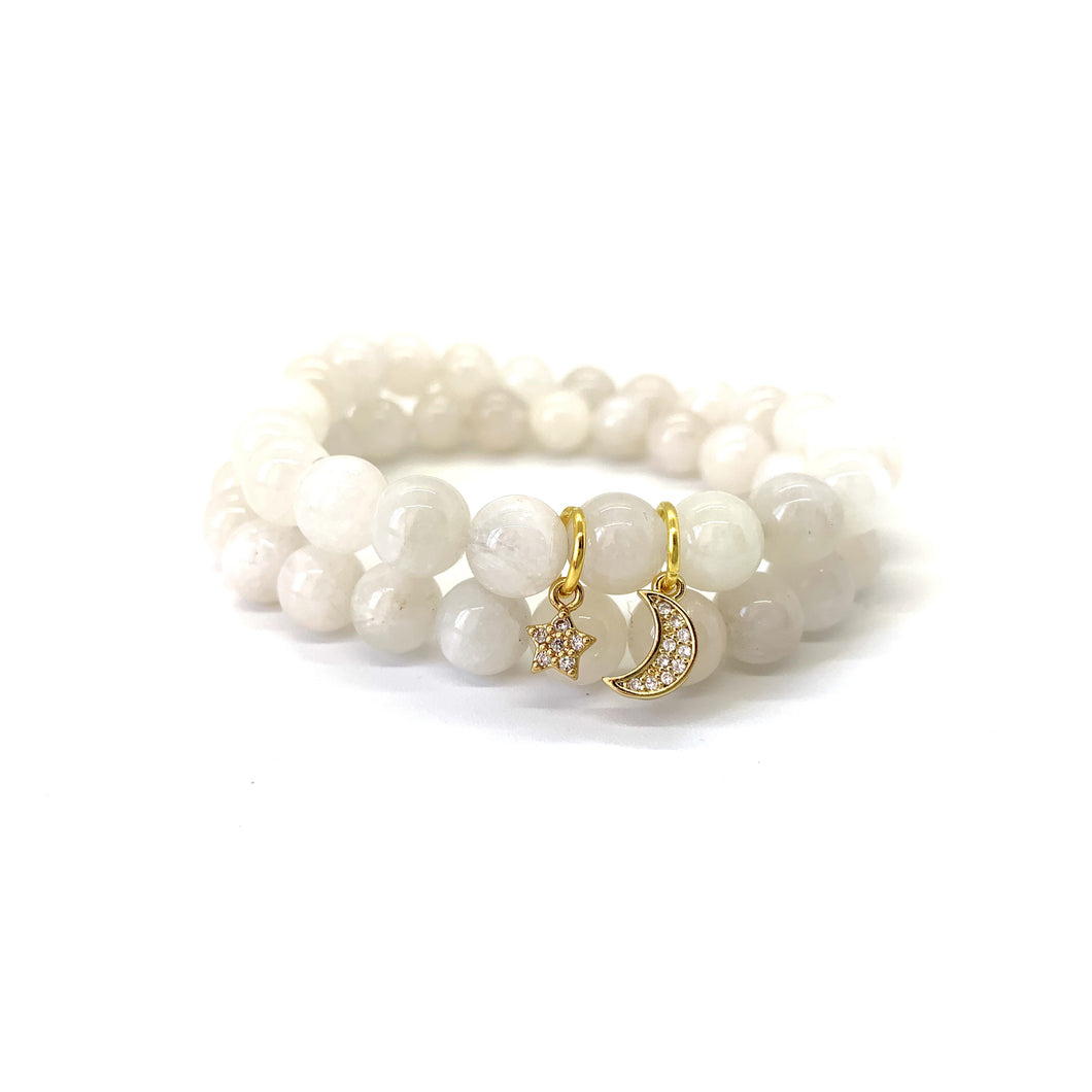 Bracelet materials include 8mm moonstones on an elastic cord w/ an 18k gold-plated star and a gold-plated crescent moon charm that is adorned w/ Austrian crystals