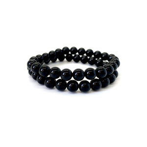 Onyx is a shiny black stone that inspires one to step into their power and is most associated with the root chakra. Bracelet materials include 8mm onyx stones on an elastic cord. Two bracelets included in this set. Custom sizing is available by Contacting Us.