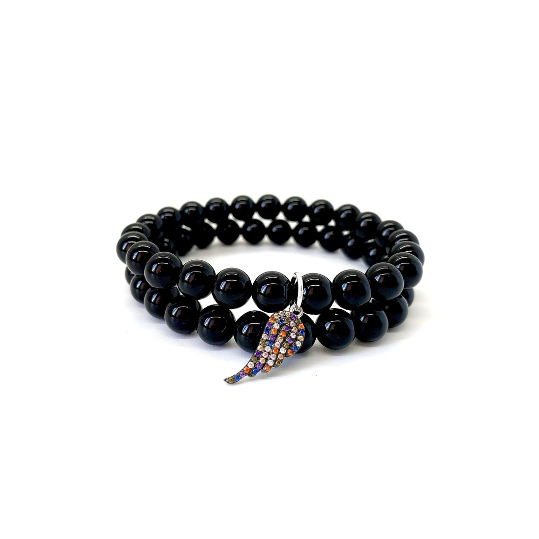 Bracelet materials include 8mm black onyx stones on an elastic cord w/ a silver-plated angel wing charm that is adorned w/ multi-colored Austrian crystals