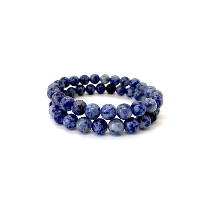 Sodalite helps stimulate truth, thought & communication and is most associated with the throat chakra. Bracelet materials include 8mm sodalite stones on an elastic cord. Two bracelets included in this set. Custom sizing is available by Contacting Us.