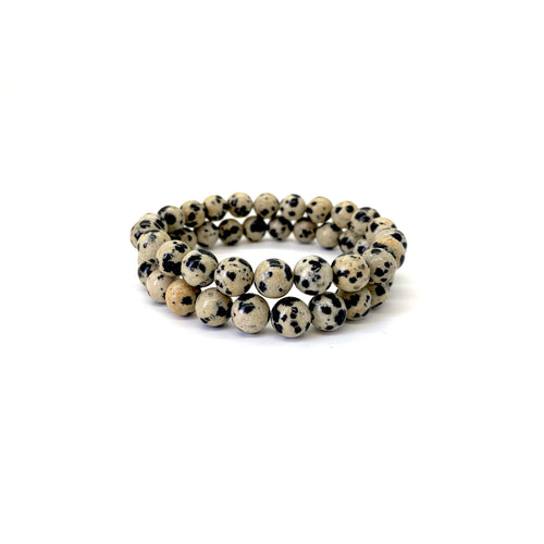 Bracelet materials include 8mm dalmatian jasper stones on an elastic cord