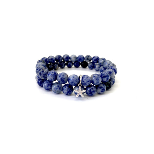 Bracelet materials include 8mm sodalite stones on an elastic cord w/ a silver-plated starfish charm that is adorned w/ Austrian crystals