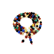 "Load image into Gallery viewer, Ignite all your chakras with this vibrant multi-colored rainbow mala. Materials include 108, 6mm multi-colored stones that are strung on an elastic (stretch) cord for comfort & durability.  This mala is unisex and will likely wrap four times around the wrist for women & three for men. If worn as a necklace, it measures 28"" inches. A mala is a set of beads that are used as a meditation tool or as a simple reminder to stay present throughout the day."