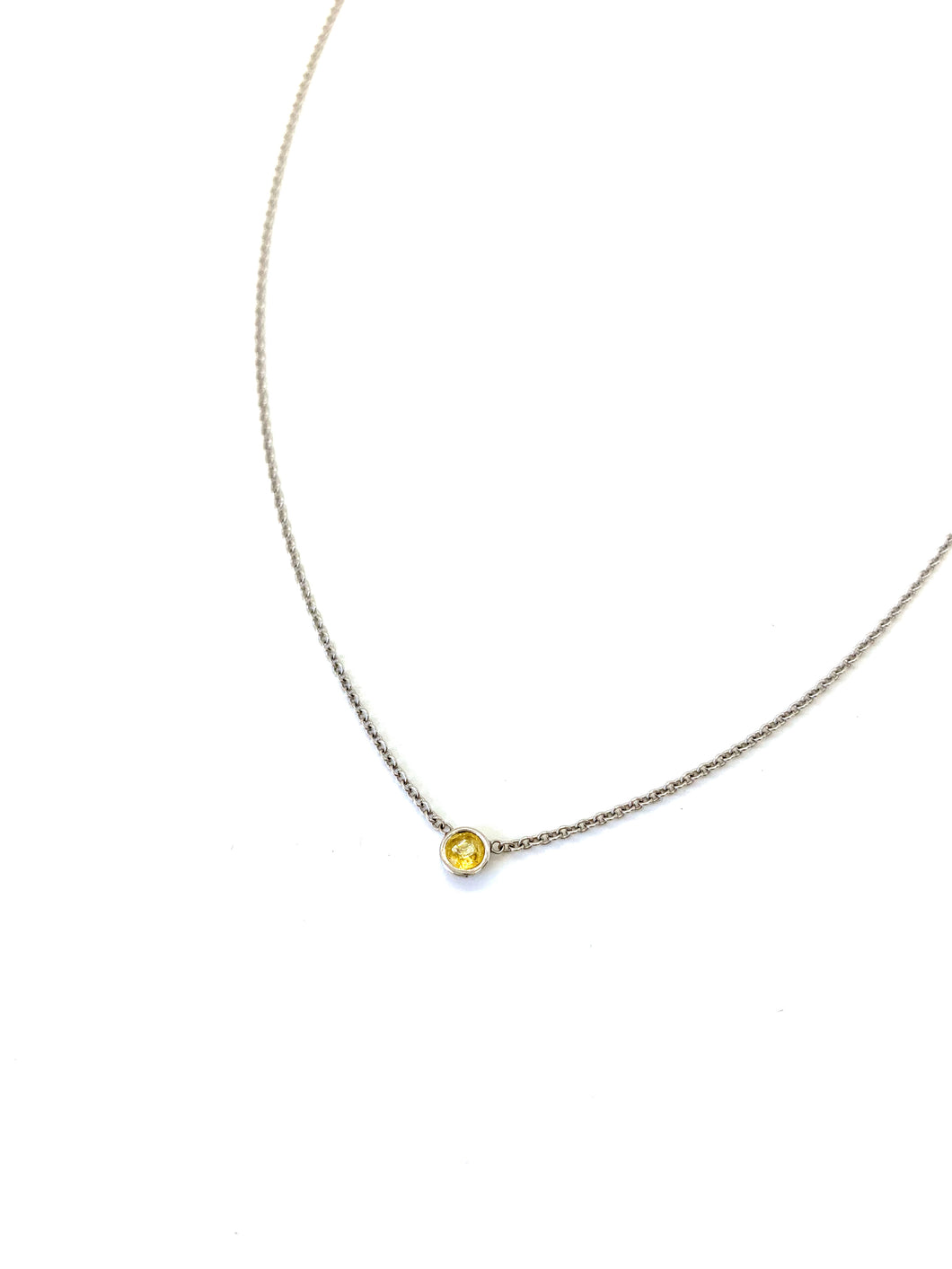 Materials include a 16-inch 14k white gold chain w/ a 3mm yellow sapphire gemstone