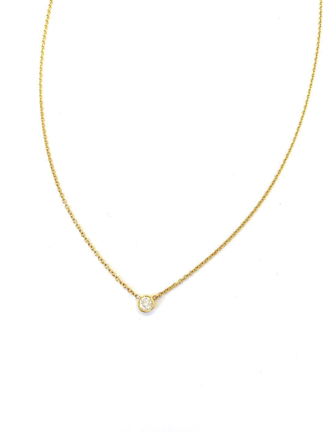 Materials include a 16-inch 14k yellow gold chain w/ a 3mm brilliant diamond