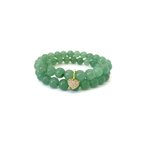 Bracelet materials include 8mm aventurine stones on an elastic cord w/ an 18k gold-plated heart charm that is adorned w/ Austrian crystals
