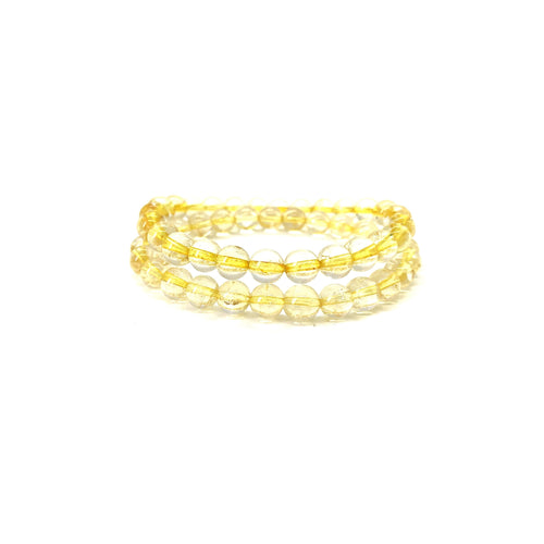 Bracelet materials include 8mm citrine stones on an elastic cord