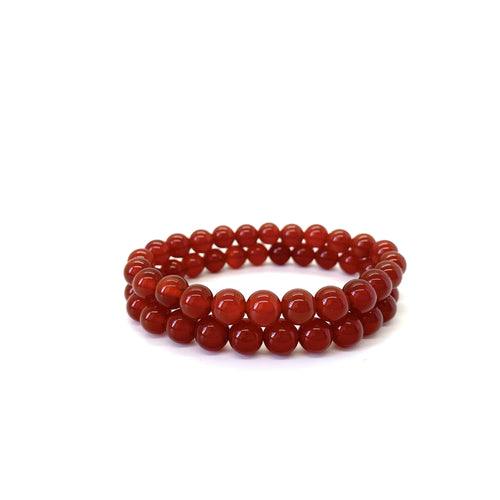 Bracelet materials include 8mm red agate stones on an elastic cord