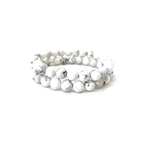 Howlite is a white marbleized stone that promotes awareness and is most associated with the crown chakra. Bracelet materials include 8mm howlite stones on an elastic cord. Two bracelets included in this set. Custom sizing is available by Contacting Us.