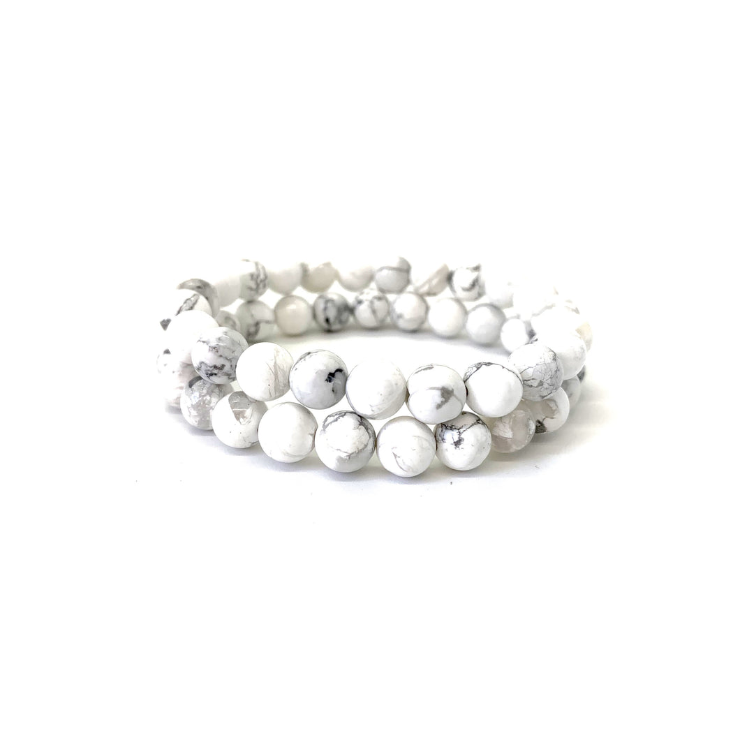 Bracelet materials include 8mm howlite stones on an elastic cord
