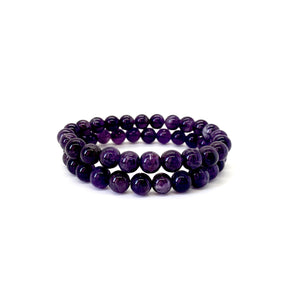 Bracelet materials include 8mm purple amethyst stones on an elastic cord