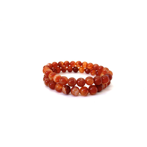Bracelet materials include 8mm carnelian stones on an elastic cord