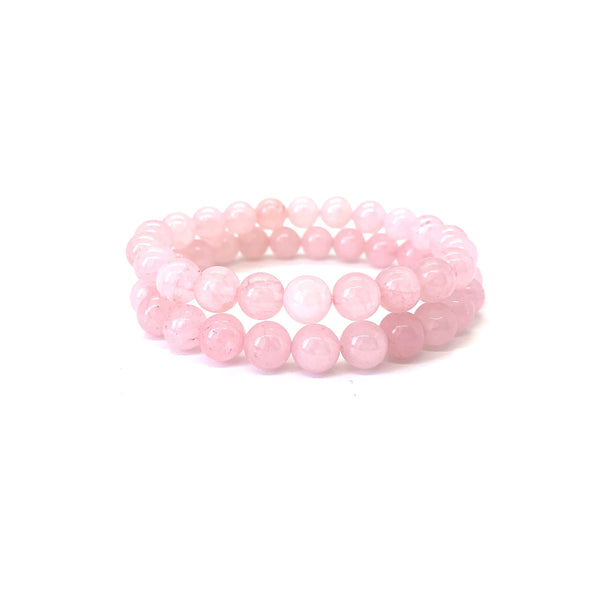 Bracelet materials include 8mm rose quartz stones on an elastic cord