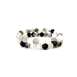 Bracelet materials include 8mm rutilated quartz stones on an elastic cord
