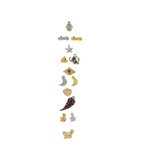 Choose a charm to enhance any bracelet or mala! Styles include a hamsa for protection, script love for loving energy, starfish for resiliency, elephant for luck, eye to protect, a crescent moon for action, heart for love, angel wing for guidance, a star for encouragement, and a butterfly for transformation. Charms are either silver-plated or 18k gold-plated with Austrian crystals. Sizes vary from 3mm-12mm.