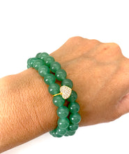 Load image into Gallery viewer, The heart is a symbol of love and brings forth loving energy! Aventurine is a green stone that brings forth prosperity, luck & abundance and is most associated with the heart chakra. It is also a stone that helps with fertility. Bracelet materials include 8mm aventurine stones on an elastic cord with an 18k gold-plated heart charm that is adorned w/ Austrian crystals. Both bracelets measure 7.25 inches. Charm is lead & nickel free. Custom sizing is available by Contacting Us.