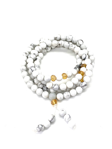 Materials include 108, 6mm howlite stones with crystal spacer beads that are strung on an elastic (stretch) cord for comfort & durability